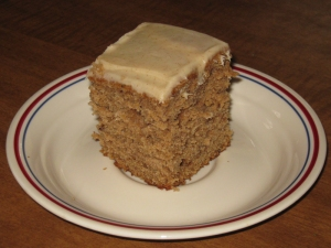a piece of applesauce cake cinnamon cream cheese frosting