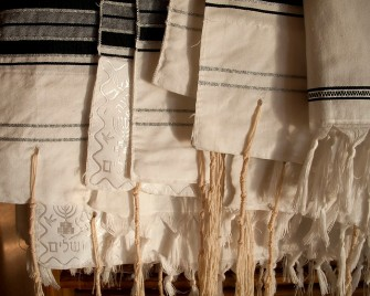 Tallitot (prayer shawls) by  Robert Couse-Baker, CC BY via Flickr